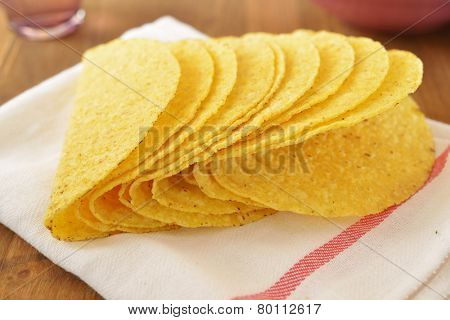 Crusty taco shells on a rustic table