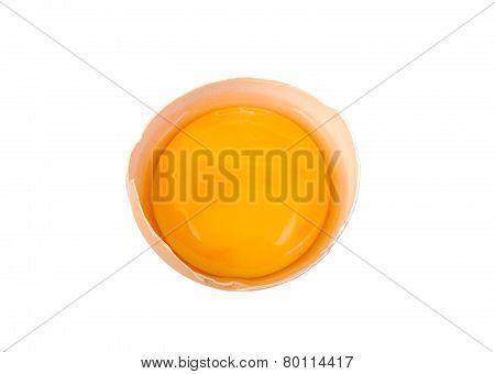 Yolk in broken egg isolated on white background.
