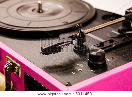 Old vintage good looking turntable playing a track with vinyl.
