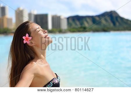 Enjoyment - Beach woman in bikini on Waikiki, Oahu, Hawaii, USA. Girl on travel vacation holidays relaxing serene having fun on Hawaiian Waikiki beach with Diamond Head mountain. Asian Caucasian model