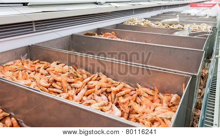 Showcase With Frozen Seafood In The Supermarket