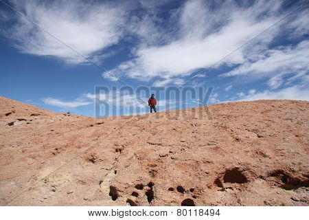 Tourist man on the top of Volcano, Uyuni, Bolivia