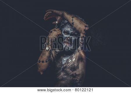 warrior naked wild man with tribal paint