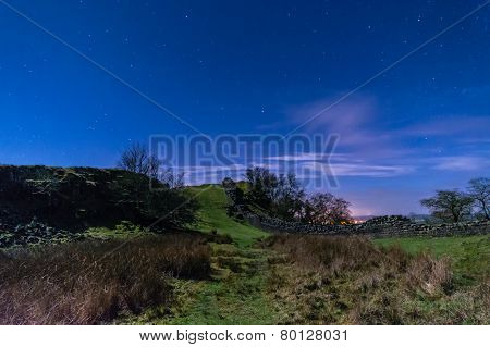 Hadrians Wall In A Valley At Night