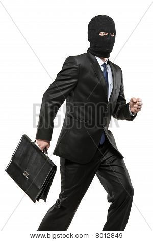 A man in robbery mask carrying a briefcase