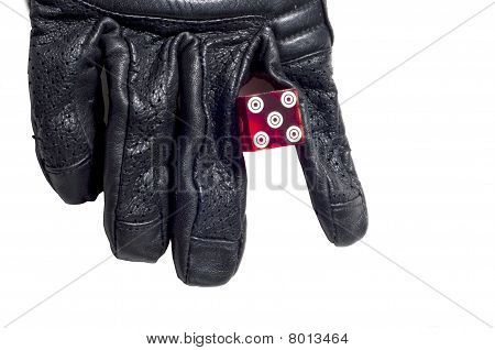 Dice Held By Black Glove Isolated On White Background