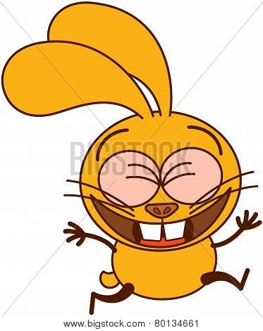 Cute yellow bunny running and celebrating