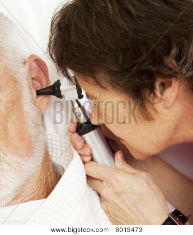 Nurse Or Doctor Using Otoscope