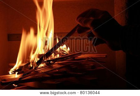 Man Lighting Up The Chimney Fire