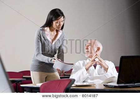 Doctor And Female Assistant In Conference Room