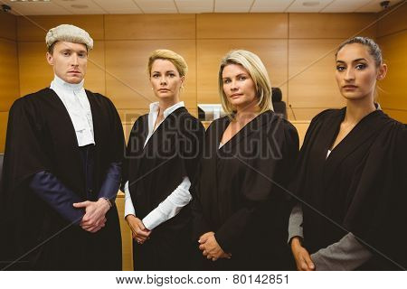 First judge standing while wearing a wig in the court room