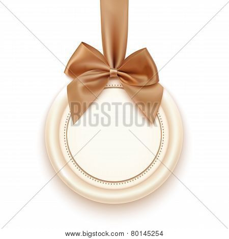 Blank badge with golden ribbon and bow.
