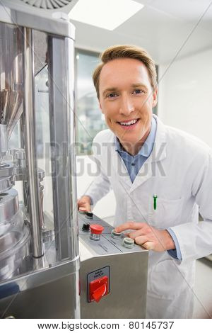 Happy pharmacist using advanced technology at the hospital pharmacy
