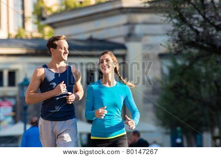 Couple running for Sport in inner city of Dresden