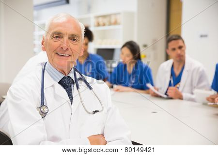 Medical professor smiling at the camera during class at the university