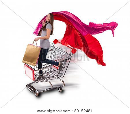 Happy young woman with shopping bags staying in basket, isolated on white background. Concept of shopping