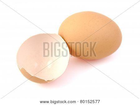 Egg and broken egg on white background.
