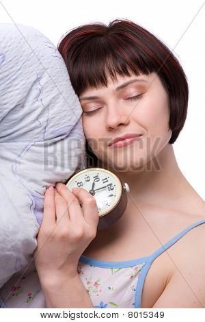 Sleepy Woman Is Sleeping And Holding Alarm Clock