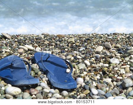 Beach Blue  Flip Flops On Pebbles Near Sea