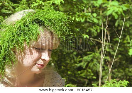 Beautiful Young Girl Wearing Floral Wreath Closeup