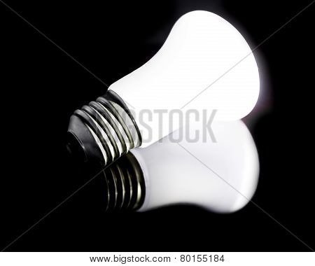 Glowing Halogen Bulb With Reflection