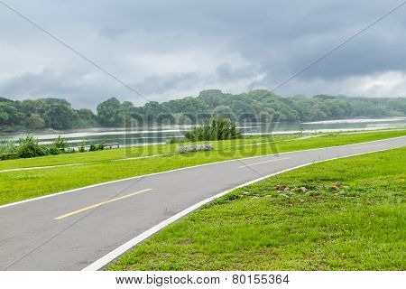 Jogging And Bicycle Path By Riverside