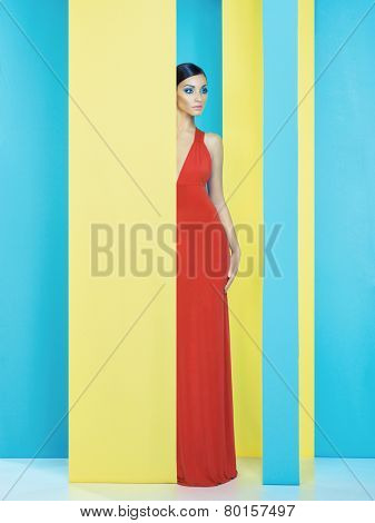 Beautiful lady with colorful makeup on colorful background