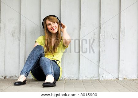 Teenage girl wearing headphones