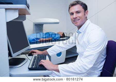 Portrait of a smiling doctor in radiography room in hospital