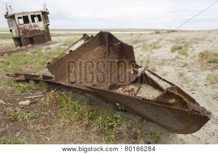Rusted remains of fishing boat,  Aralsk, Kazakhstan.