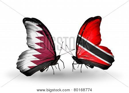 Two Butterflies With Flags On Wings As Symbol Of Relations Qatar And  Trinidad And Tobago