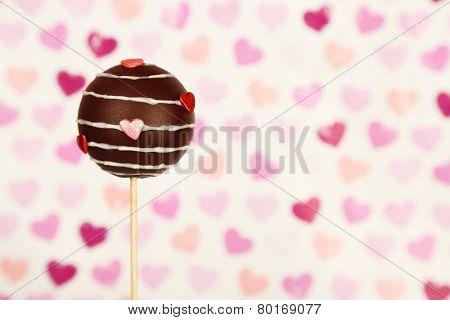 Tasty cake pop on color background