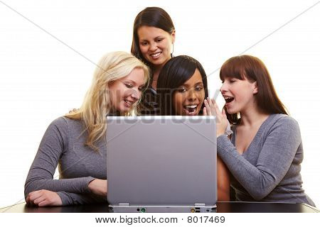 Women Chatting With A Laptop
