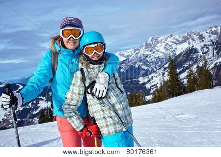 mother and daughter skiing