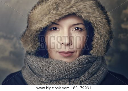 Woman In Fur Hood And Knitted Scarf