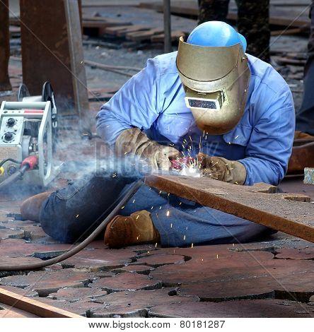 Welder Using The Shielded Metal Arc Process