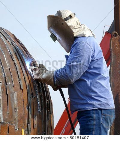 Welder At Work Using The Shielded Metal Arc Process