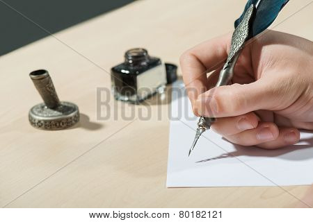 Writing with feather close up