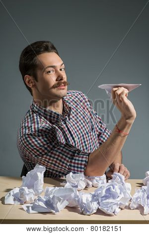 Author throwing paper planes