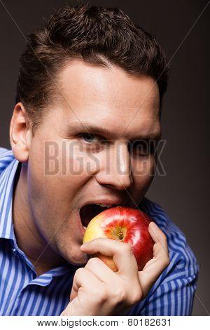 Diet Nutrition. Happy Man Biting Apple Fruit