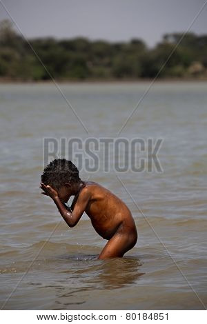 The African Boy Washing In The River.