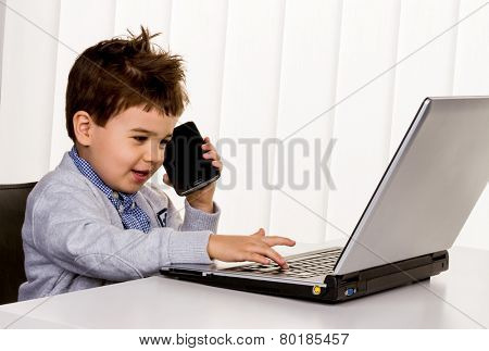 little boy on a laptop, symbol of the internet, e-commerce, consumer behavior