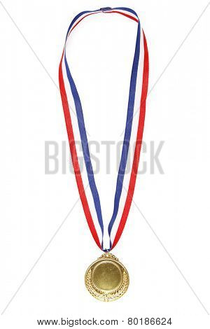 Closeup of gold medal on plain background