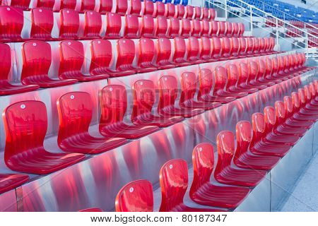 Empty Plastic Red Chairs at the Stadium