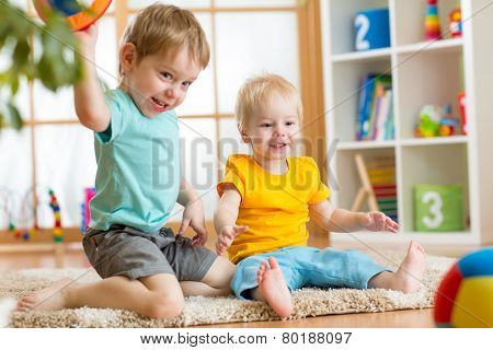kids playing with ball in playroom