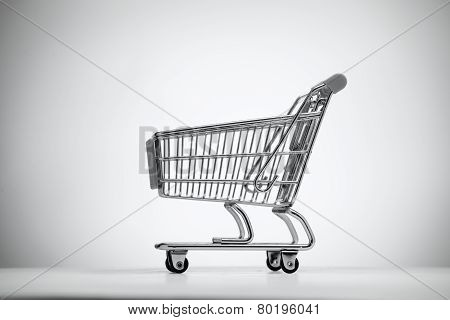 Empty Shopping Cart On Light Background.
