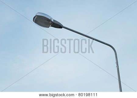 photo of street lamppost on sky background