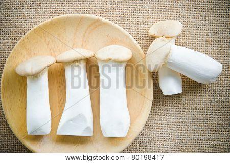 King Oyster Mushrooms (pleurotus Eryngi) In Wooden Dish.