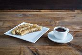 foto of churros  - churros con chocolate a typical Spanish sweet snack on old wooden table - JPG