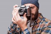 foto of macho man  - Handsome young bearded man photographing you with his old - JPG